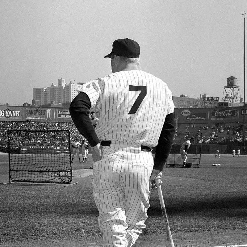 Yankee slugger Mickey Mantle leans on his bat