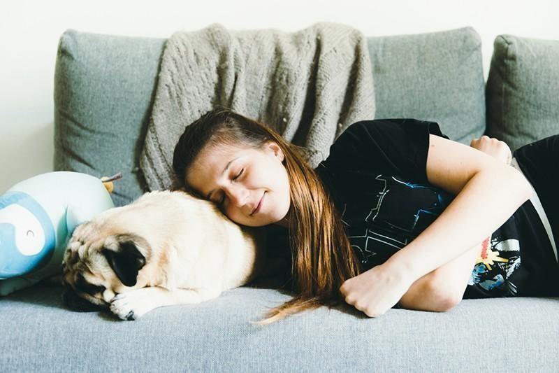 woman and pug sleeping