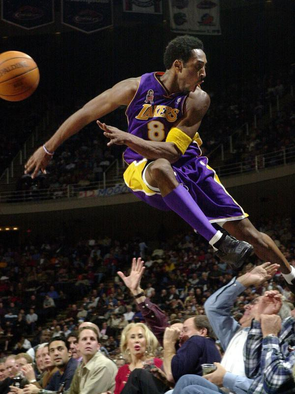 Kobe Bryant jumps over a row of fans
