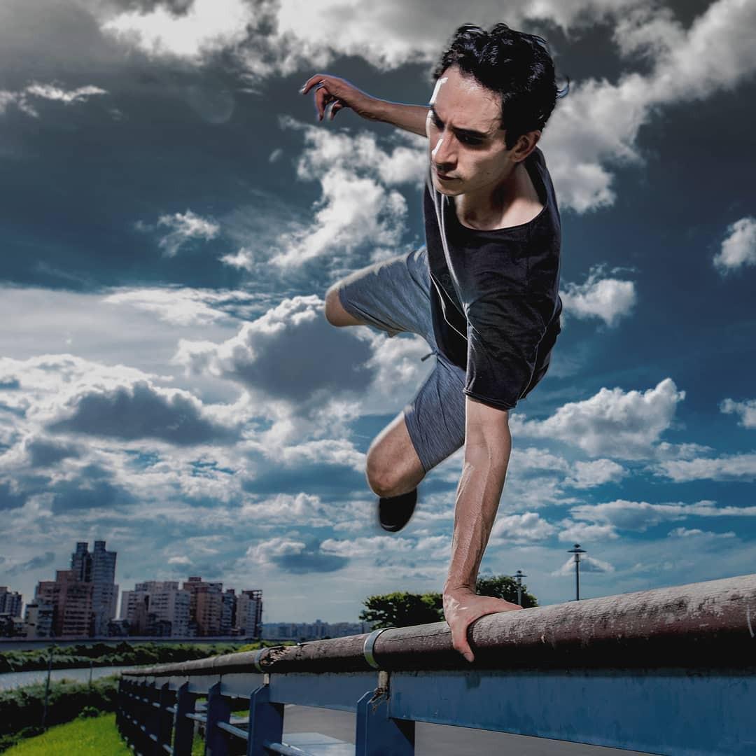 Man doing stunt on railing