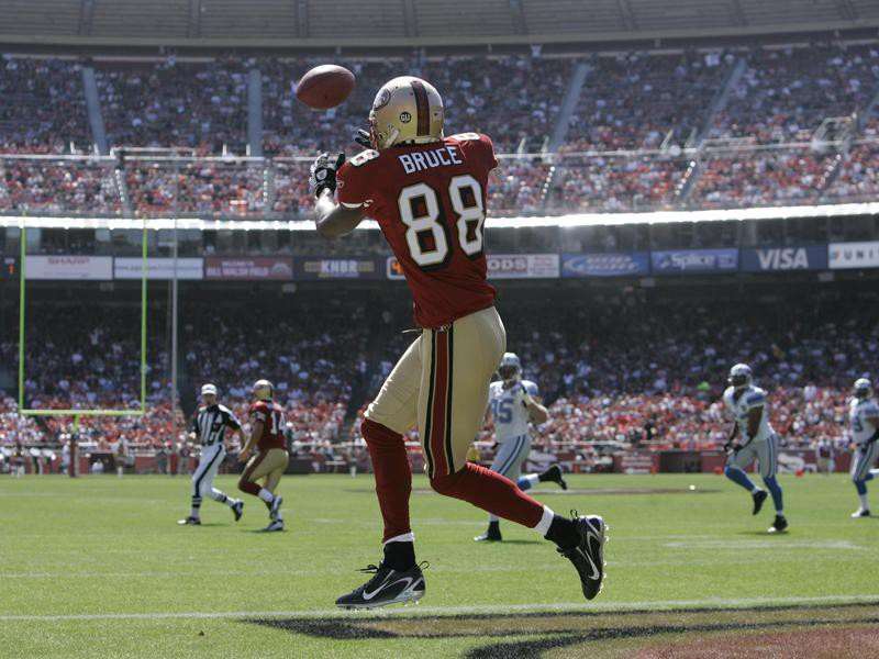 San Francisco 49ers' Isaac Bruce looks to catch pass in NFL football game