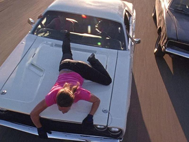 Zoe Bell Hanging Onto the Hood of a Car
