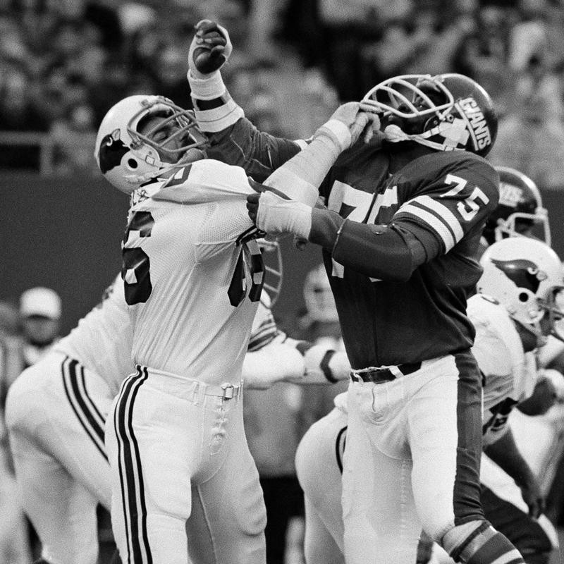 Conrad Dobler attempts to block George Martin of the New York Giants