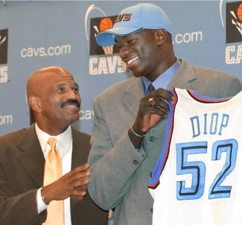 DeSagna Diop holding up jersey