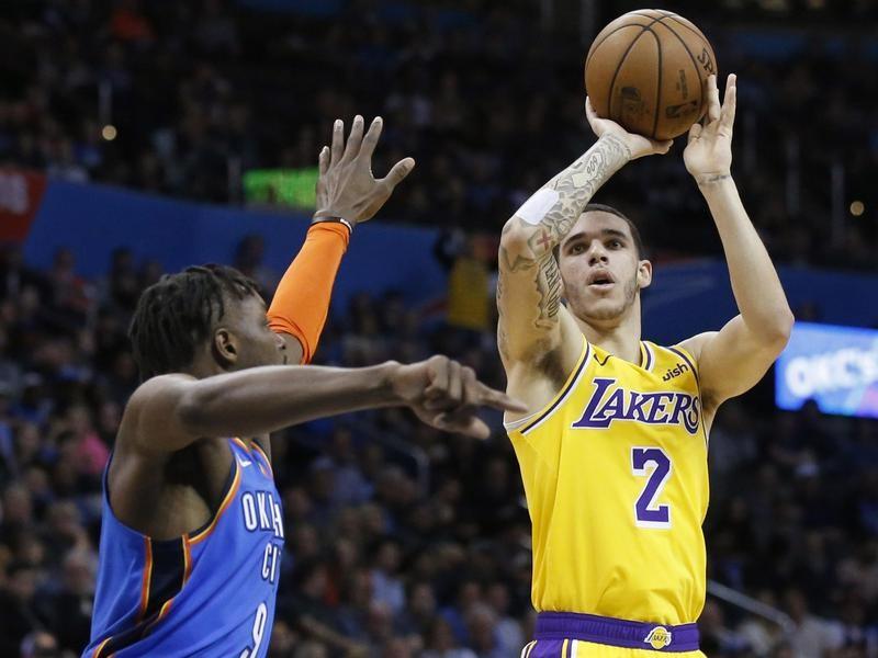 Lonzo Ball shoots against Jerami Grant of Oklahoma City Thunder