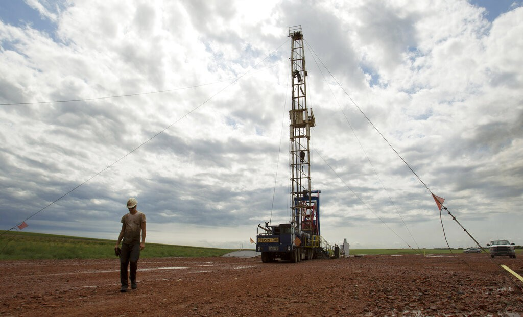 Oil field and worker
