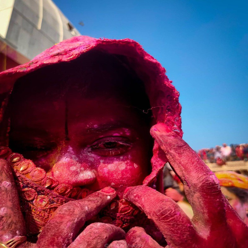 Woman covered in colors during Holi