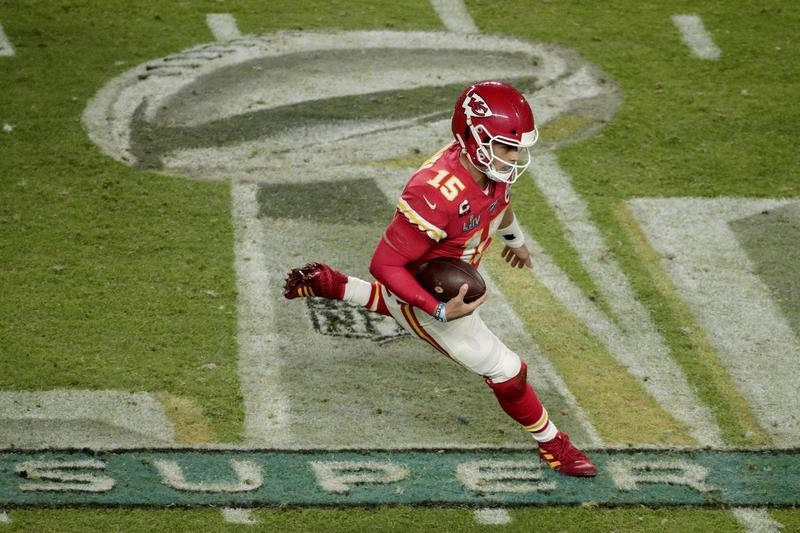 Patrick Mahomes runs with the ball in the Super Bowl
