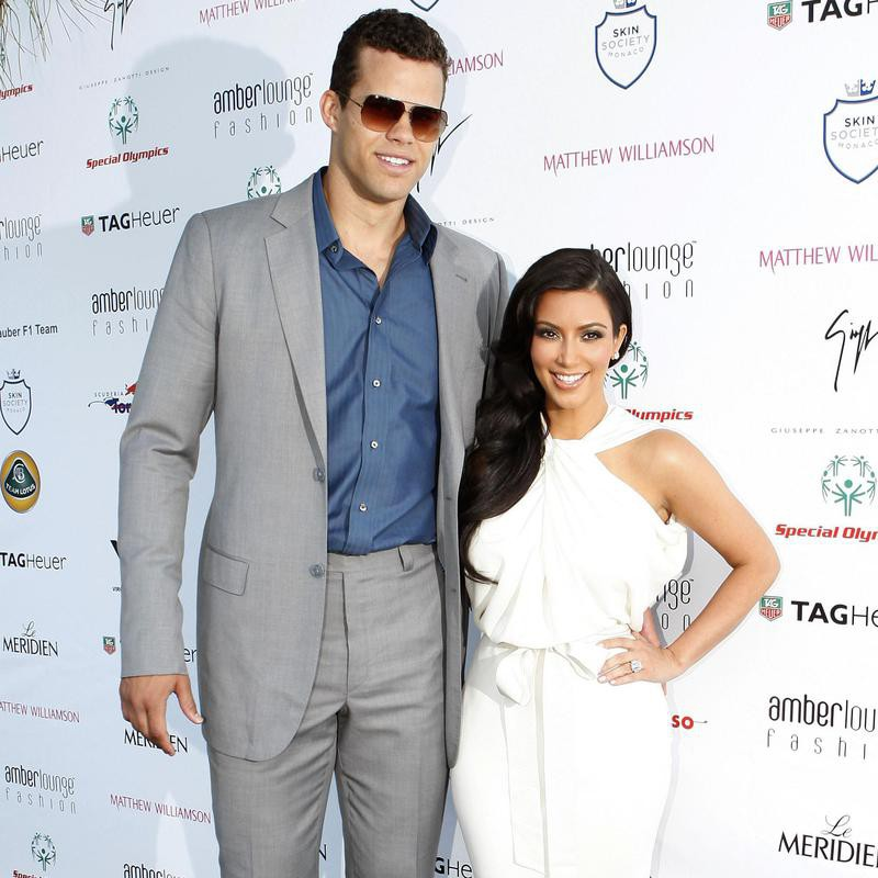 Kim Kardashian and Kris Humphries posing
