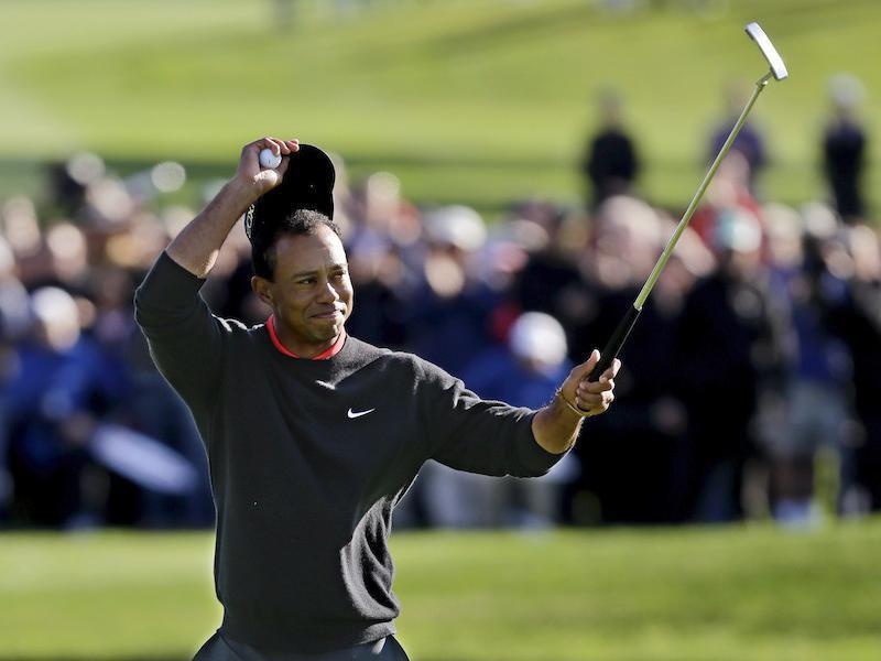 Tiger Woods celebrates after winning Farmers Insurance Open golf tournament