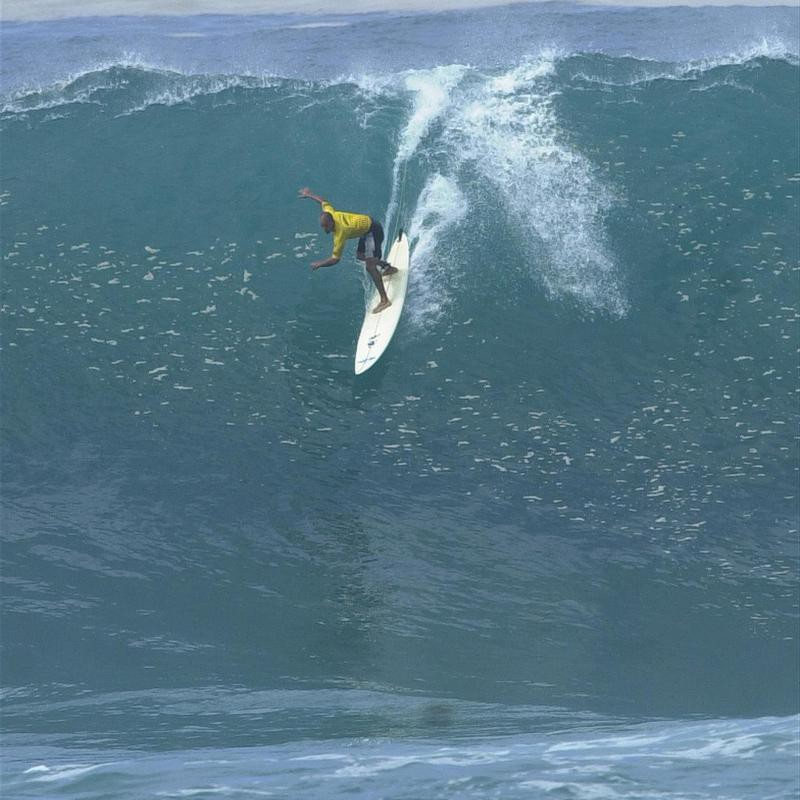 Kelly Slater surfing big waves