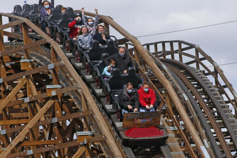 People ride the Roller Coaster