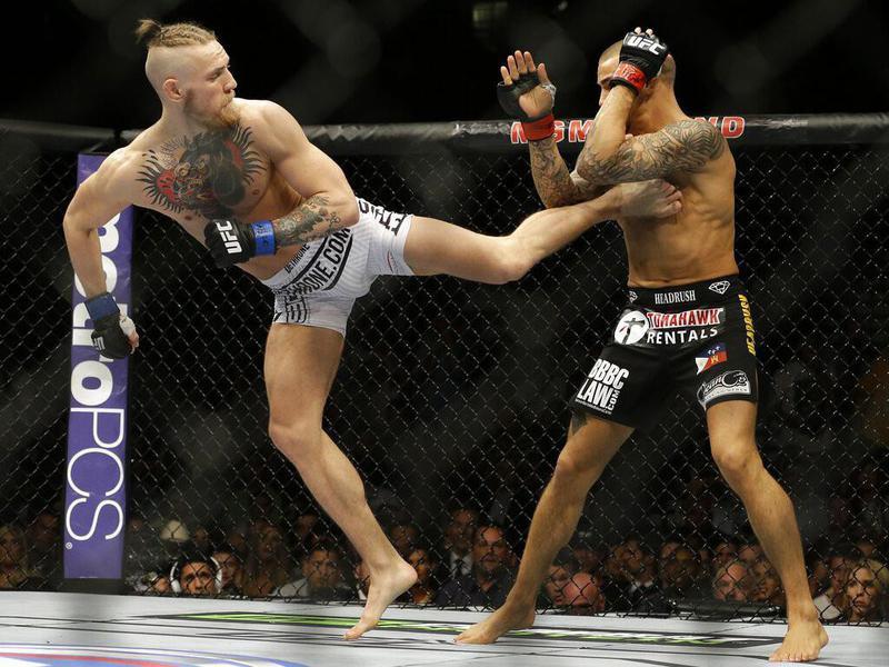 Connor McGregor kicks Dustin Poirier at UFC