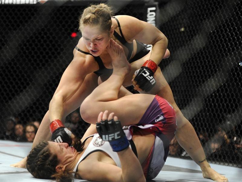 Ronda Rousey punches Miesha Tate of Yakima during UFC mixed martial arts