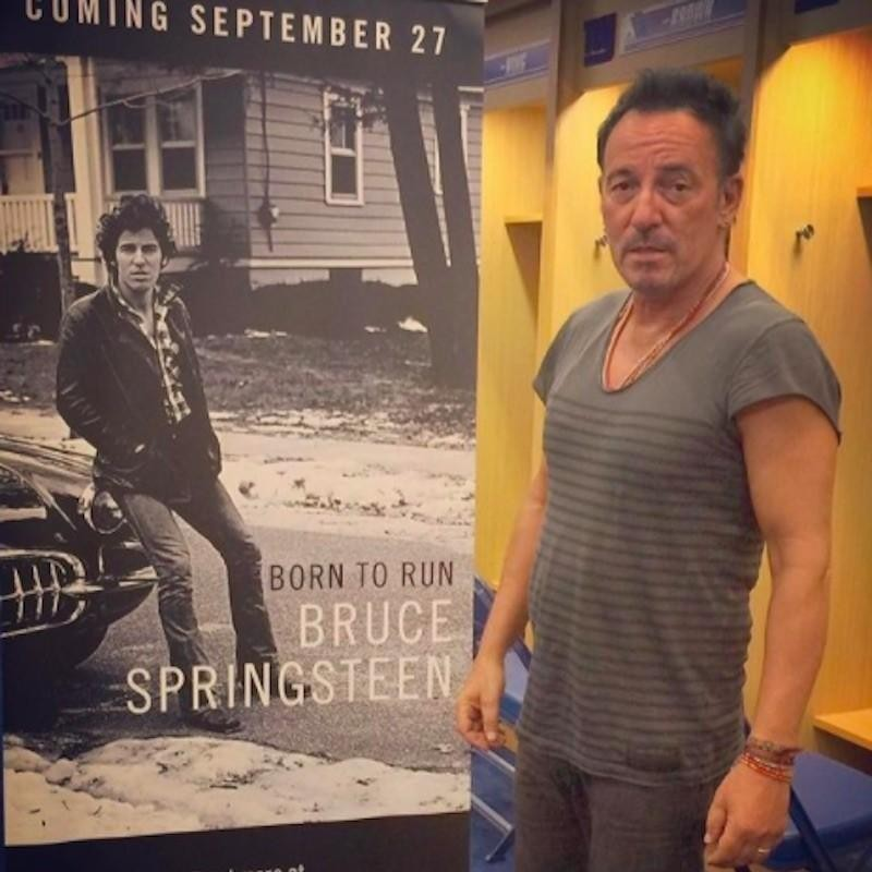 "Bruce Springsteen with ""Born to Run"" poster at MetLife Stadium in New Jersey"