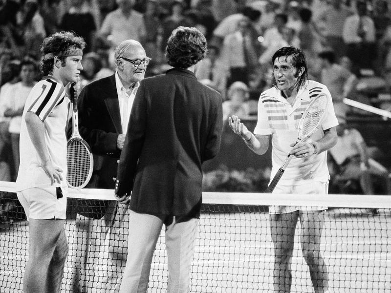 John McEnroe and Ilie Nastase