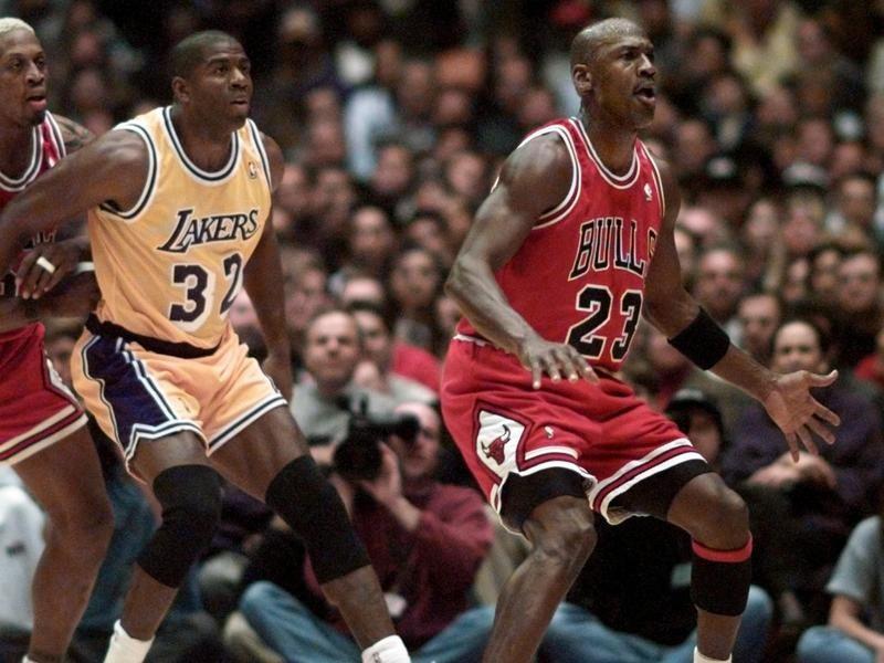 Michael Jordan and Dennis Rodman defend Magic Johnson
