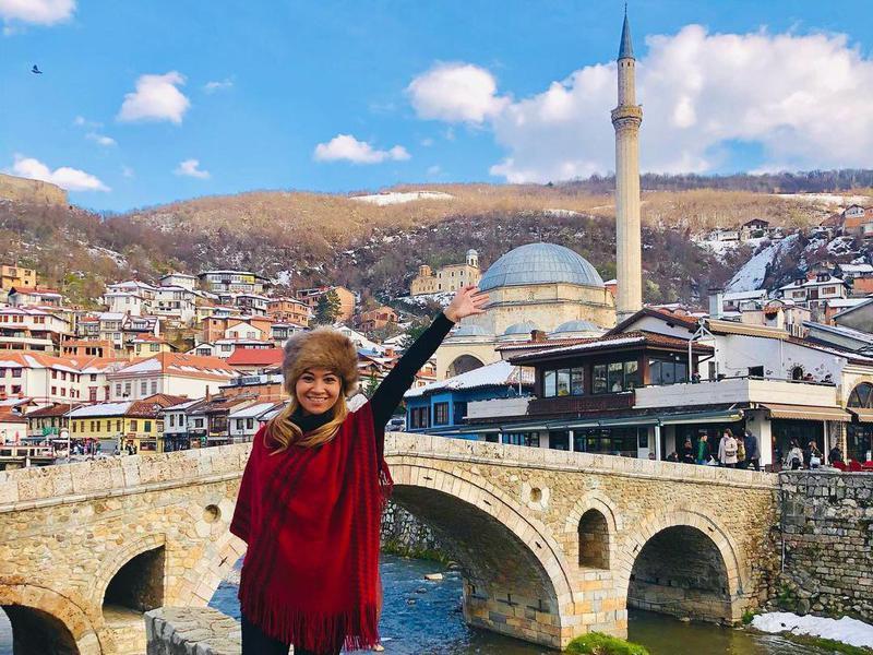 Woman smiling in Kosovo