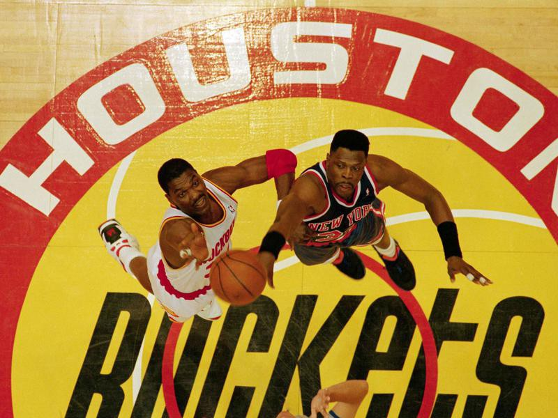 The New York Knicks' Patrick Ewing and the Houston Rockets' Hakeem Olajuwon go for opening tip