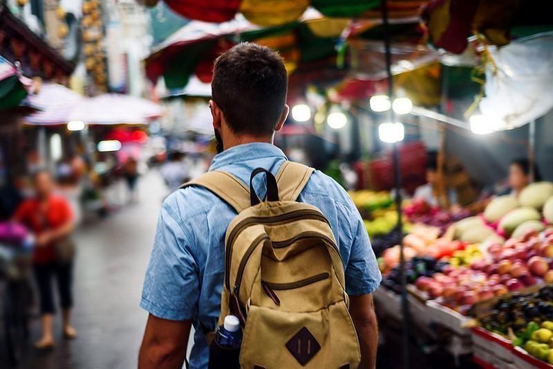 man walking through market