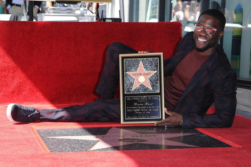 Kevin Hart poses with star on Hollywood Walk of Fame