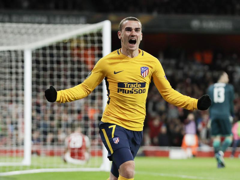 Atletico Madrid's Antoine Griezmann celebrates after scoring during a Europa League  match.