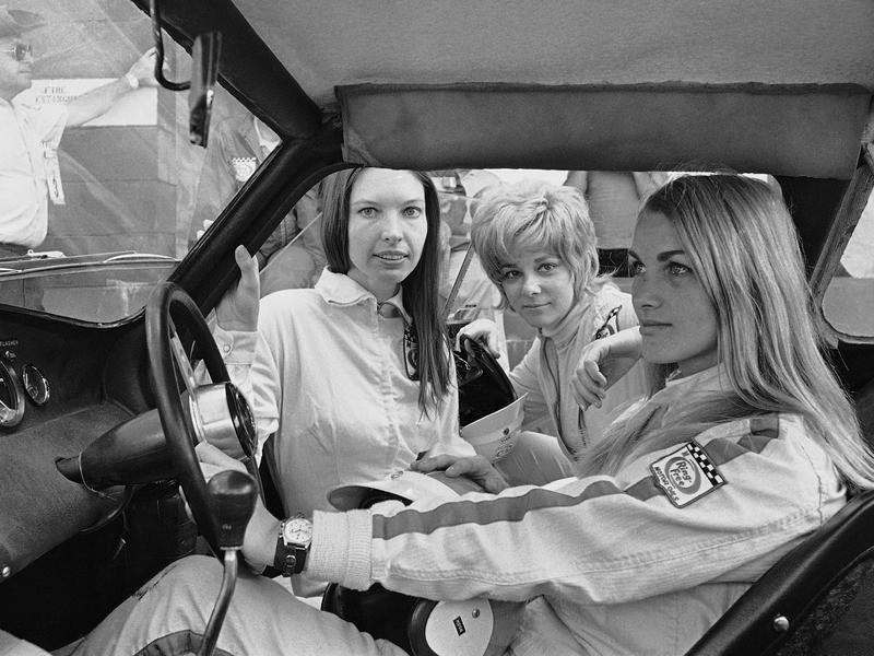Janet Guthrie and others await start of practice trails
