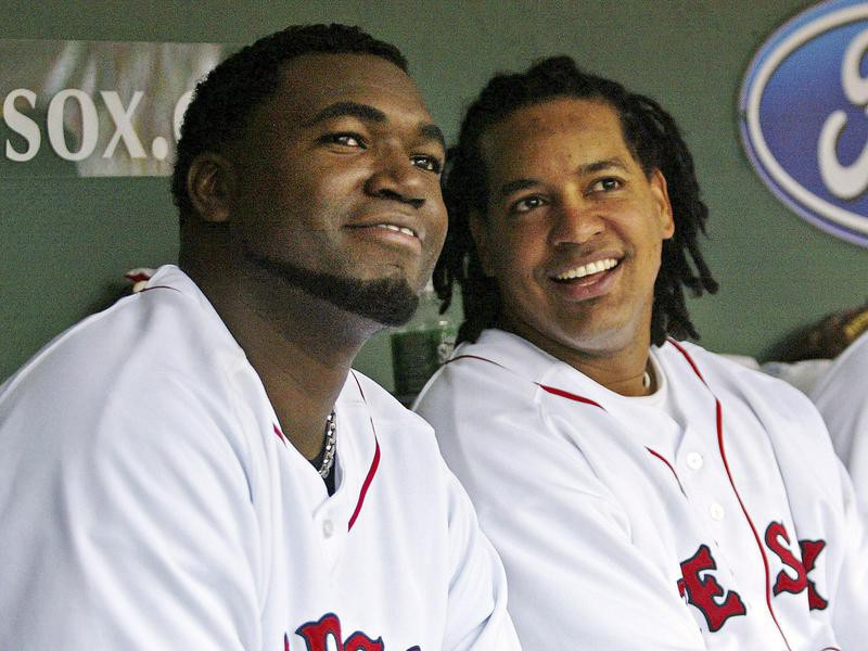 Boston Red Sox' David Ortiz sits with teammate Manny Ramirez