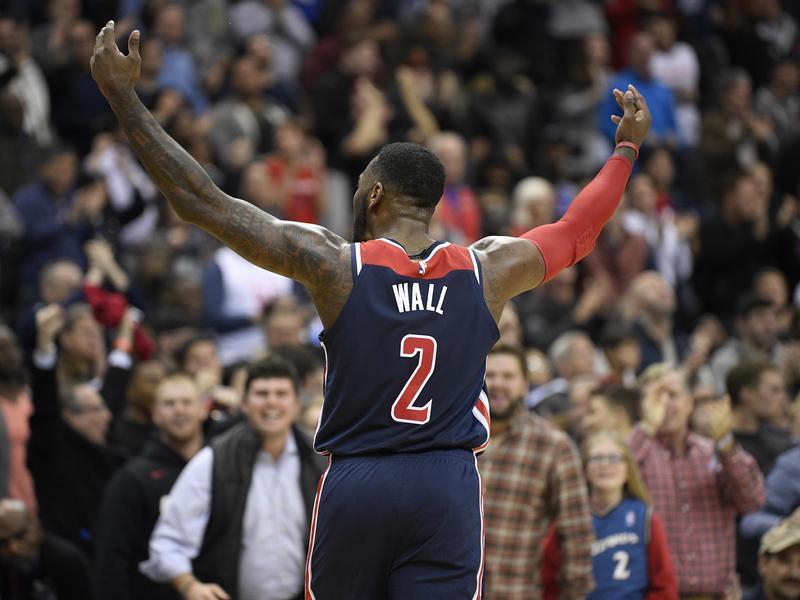 Washington Wizards guard John Wall gestures to crowd