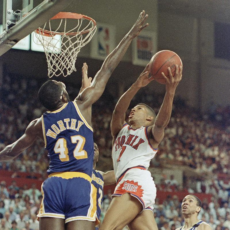 Kevin Johnson drives to basket