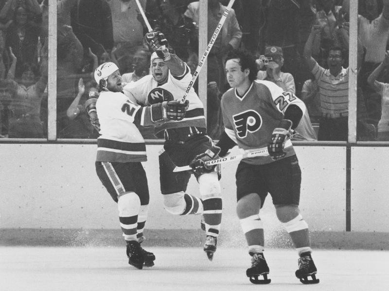 Duane Sutter celebrates with Butch Goring