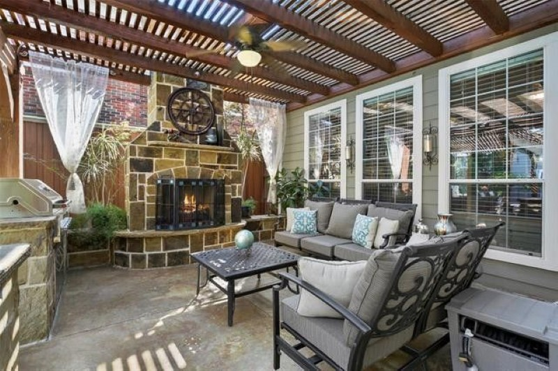 Outdoor fireplace with pergola