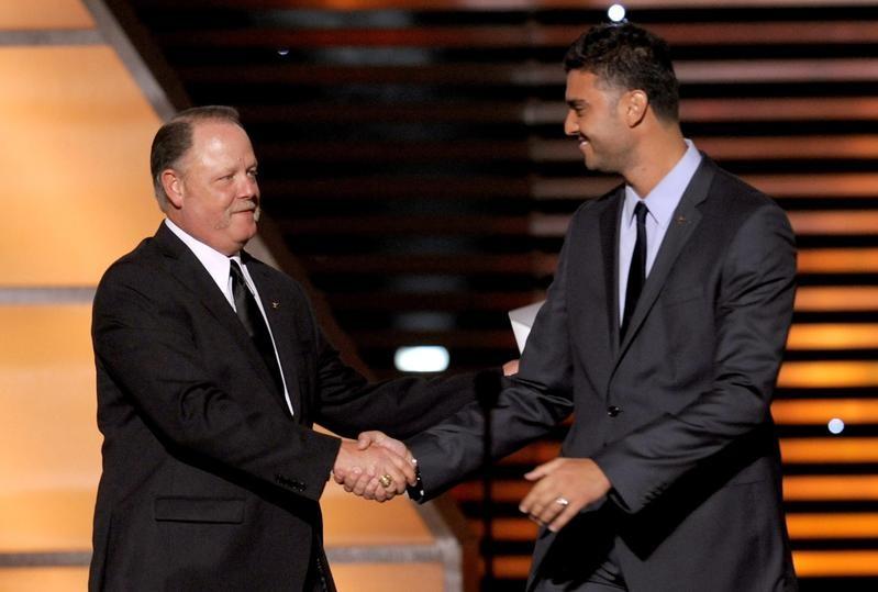 MLB umpire Jim Joyce shakes hands with Armando Galarraga of the Detroit Tigers