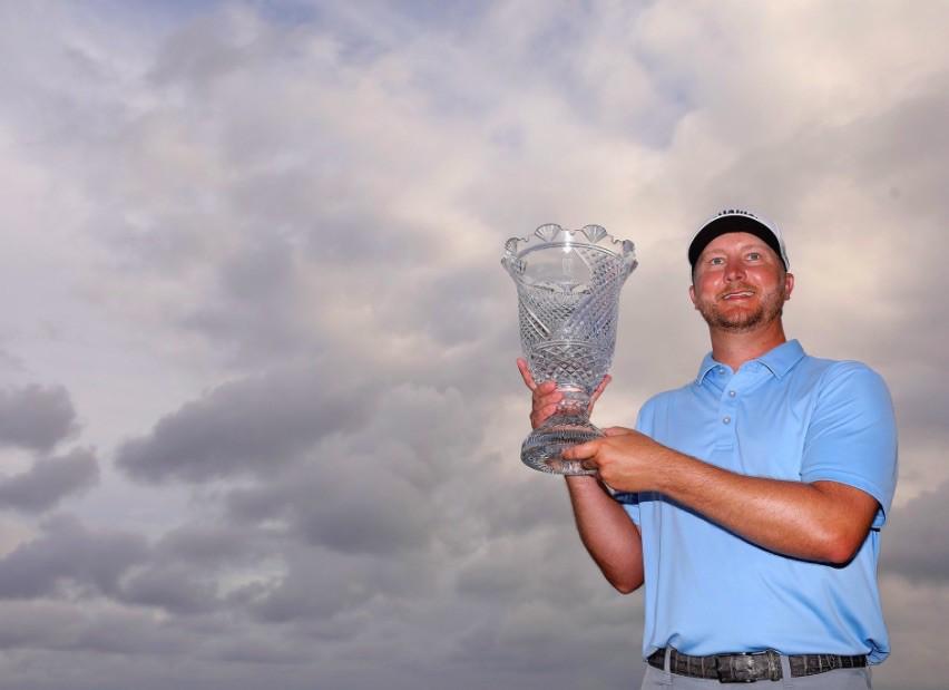 Brice Garnett holding up trophy