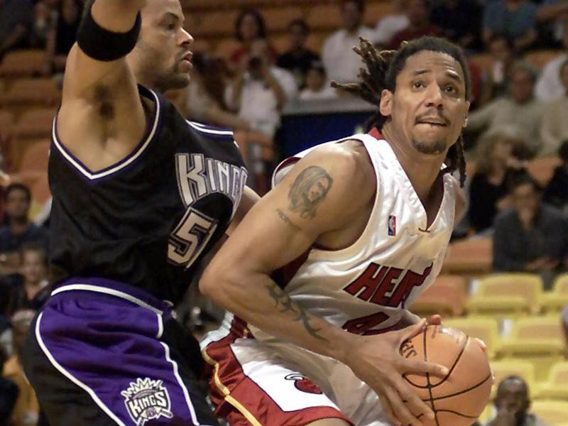 Miami Heat's Brian Grant tries to get by Sacramento Kings defender Lawrence Funderburke