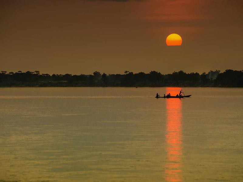 Pirogue (dugout canoe) at sunset in the Congo River