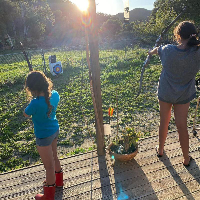 Sisters practicing archery