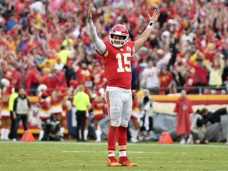 Patrick Mahomes raises his hands up after a touchdown
