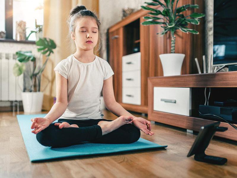 Child in lotus pose