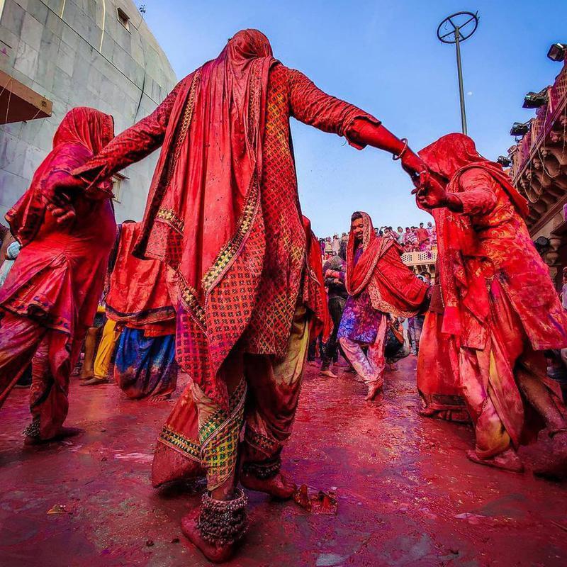 Women dancing during Holi