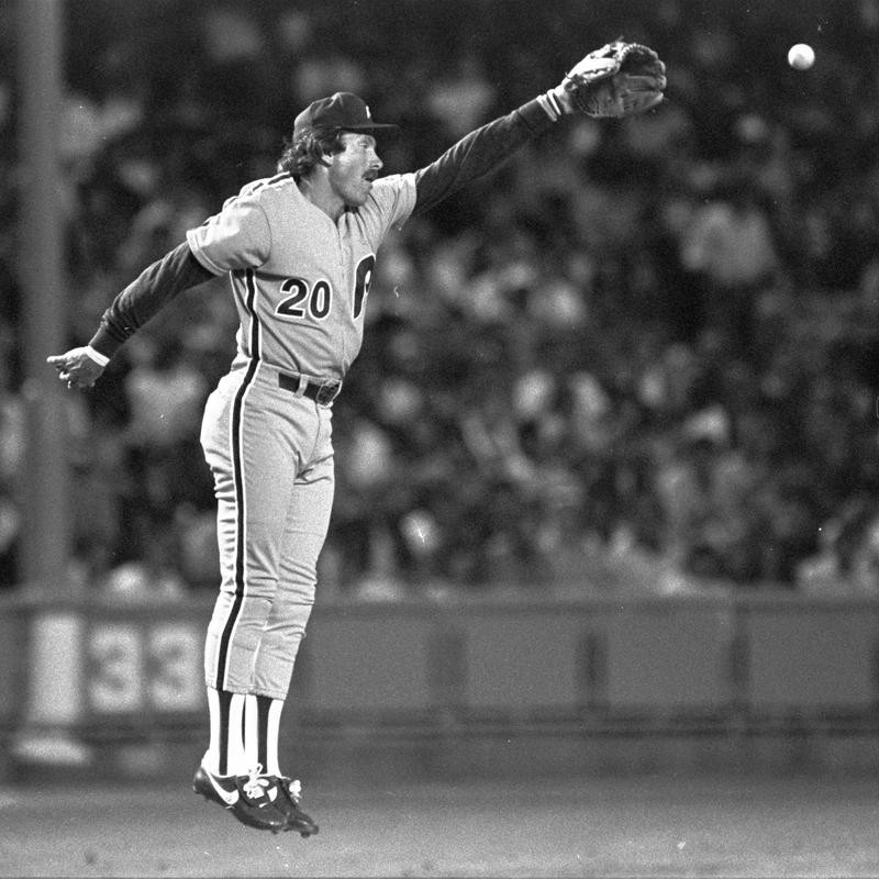 Philadelphia Phillies third baseman Mike Schmidt jumps in air to knock down fly ball