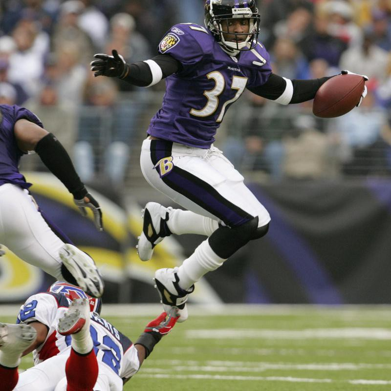 Deion Sanders of the Baltimore Ravens hops over Nate Clements