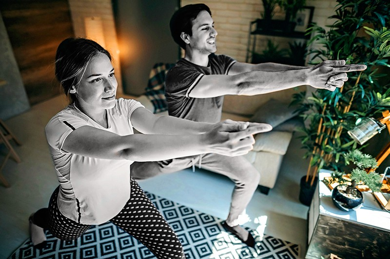 Young couple doing workout at home