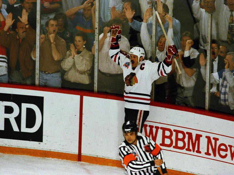 The Chicago Blackhawks' Dirk Graham celebrates after a first-period goal against the Pittsburgh Penguins
