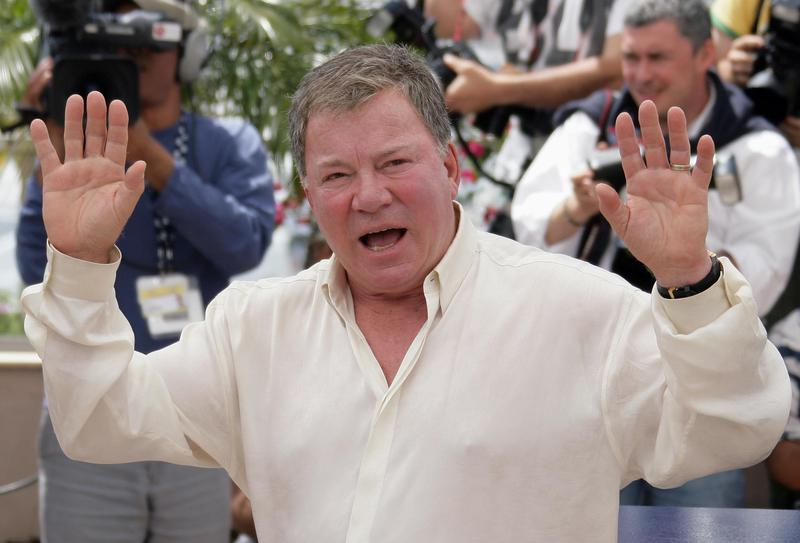 Shatner gestures at the Cannes Film Festival in France in 2006, the same year he sold his kidney stone to benefit Habitat for Humanity.