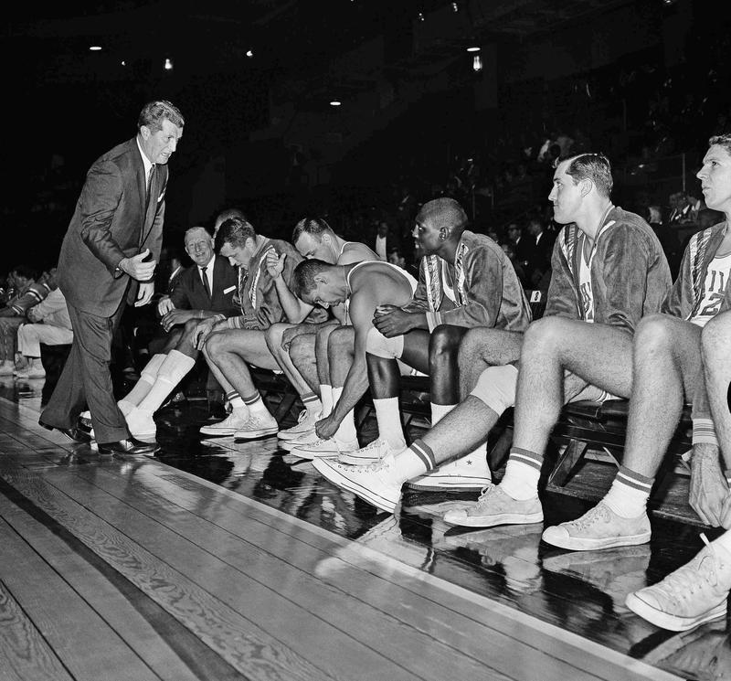 Philadelphia Warriors team sits on bench