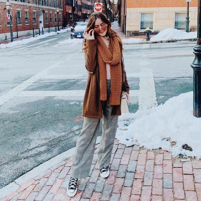Woman posing in thrifted outfit on the street