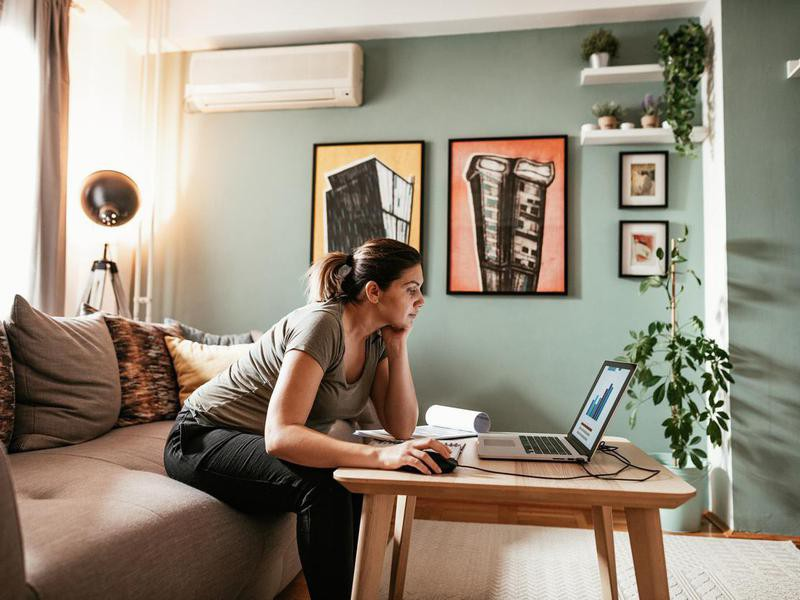 Woman working from her couch
