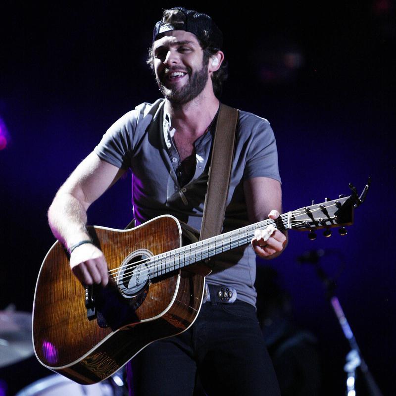 Thomas Rhett performing at CMA Fest
