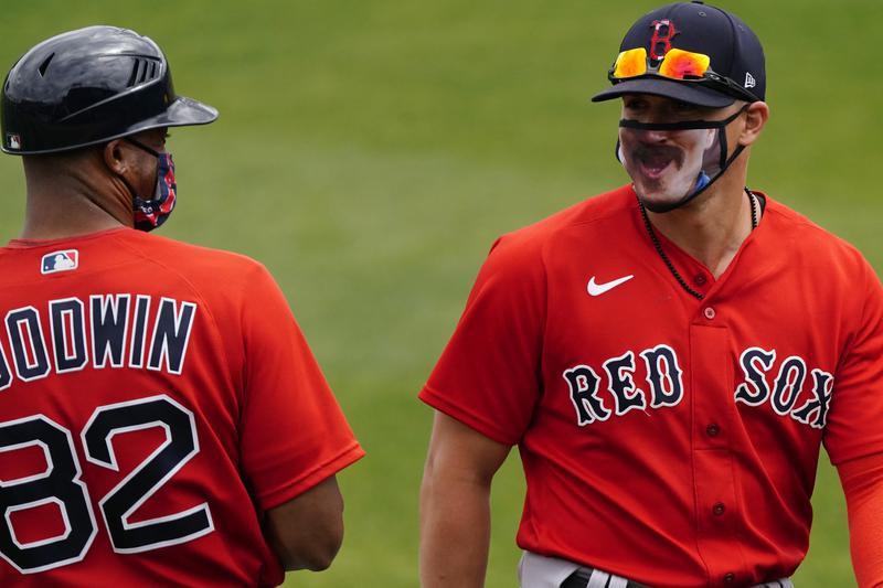 Boston Red Sox utility player Kiké Hernandez and coach Tom Goodwin